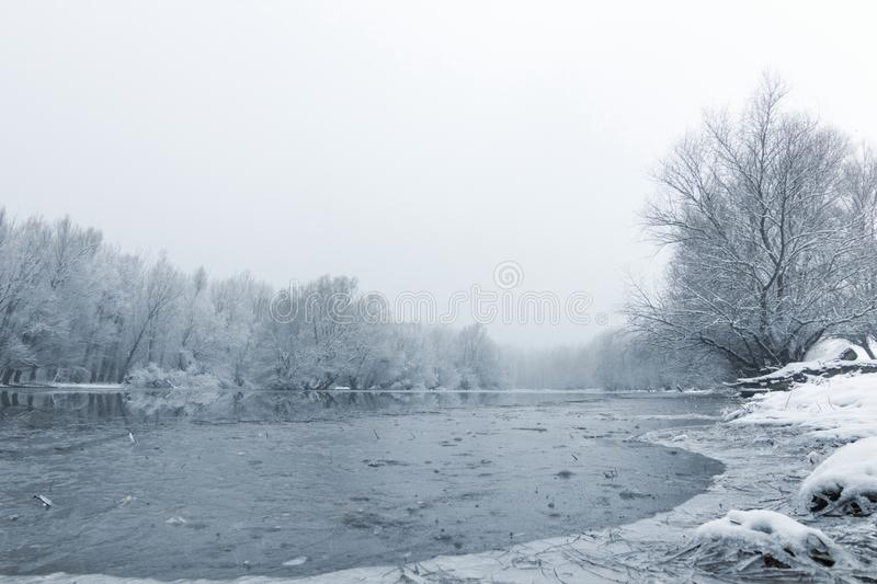 Winter lake scene reflecting in the water. Nature Background stock photo