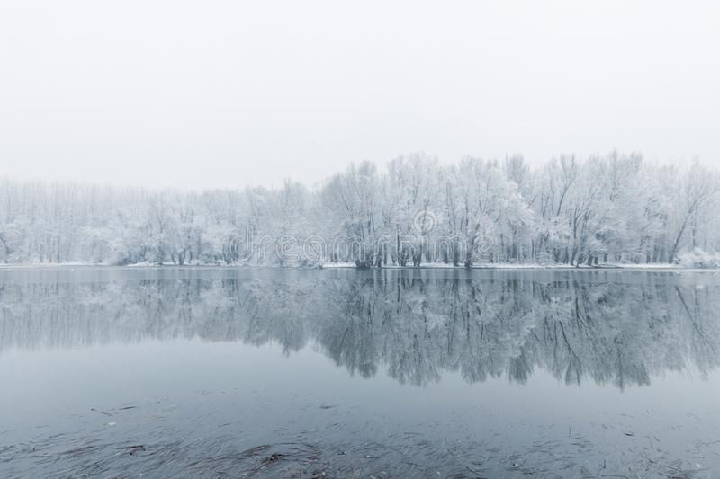 Winter lake scene reflecting in the water. Nature Background stock photos