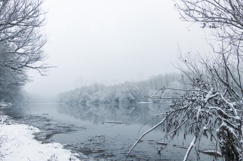Winter lake scene reflecting in the water. Nature Background stock images