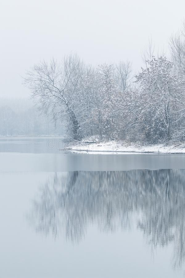 Winter lake scene reflecting in the water. Nature Background royalty free stock images