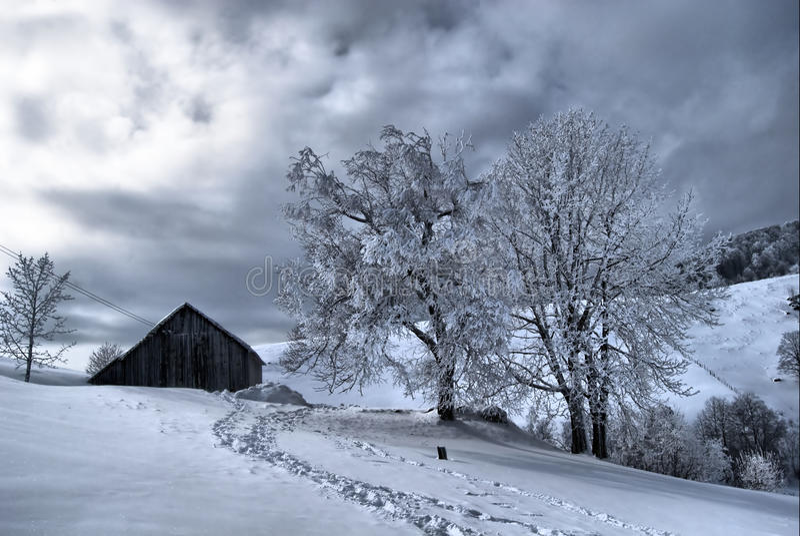 Winter landscape. Romanian village house in winter stock photos