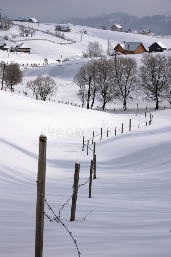Winter landscape. A village in the mountains ;Trees covered in snow; Traces in snow stock photos