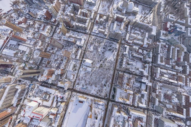 Winter landscape aerial view of the city of Novosibirsk, with the Opera and Ballet Theater, a stadium, tall buildings, houses with royalty free stock photography