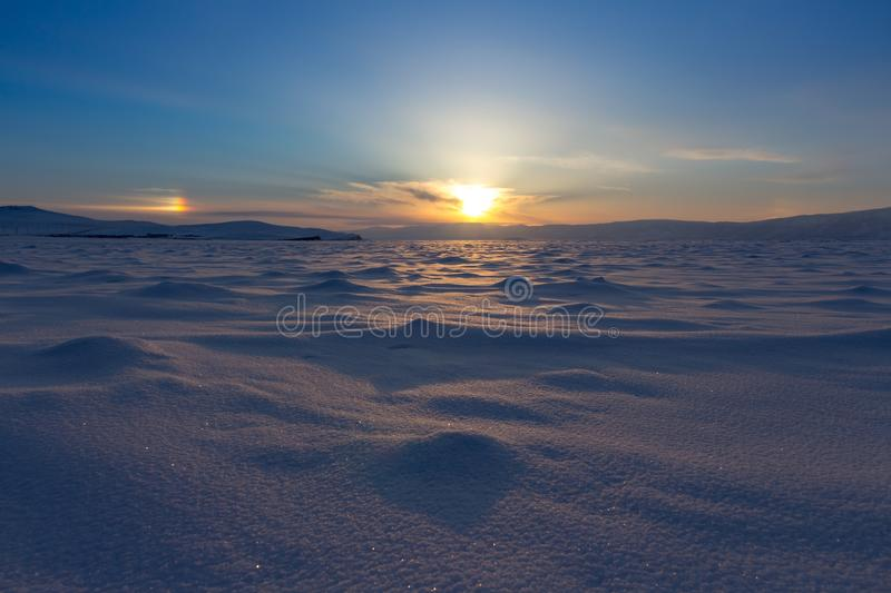 Winter landscape. Beautiful sunset in the Lake Baikal royalty free stock photo