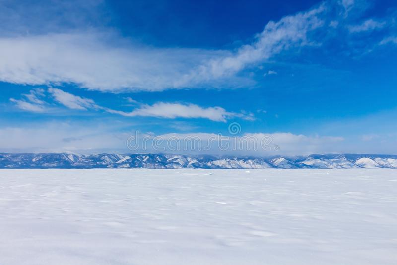 Winter landscape. Beautiful view of the snow-capped mountains in Lake Baikal royalty free stock photo