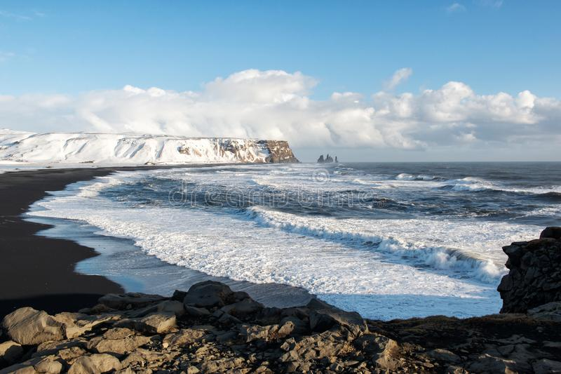 Winter landscape with black sand beach and ocean waves, Iceland. Winter sea landscape with black sand beach and ocean waves, Iceland royalty free stock image