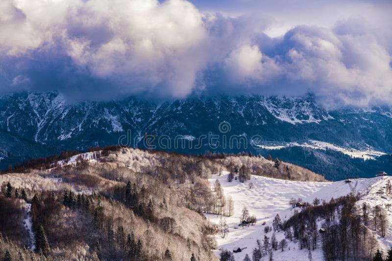 Winter landscape with Carpati Piatra Craiului mountain. Beautiful winter landscape with Carpati Piatra Craiului mountains in Romania royalty free stock photography