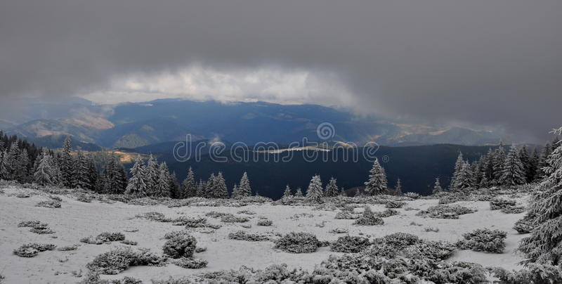 Winter landscape of a cloudly winter day. In carpathian mountains stock image