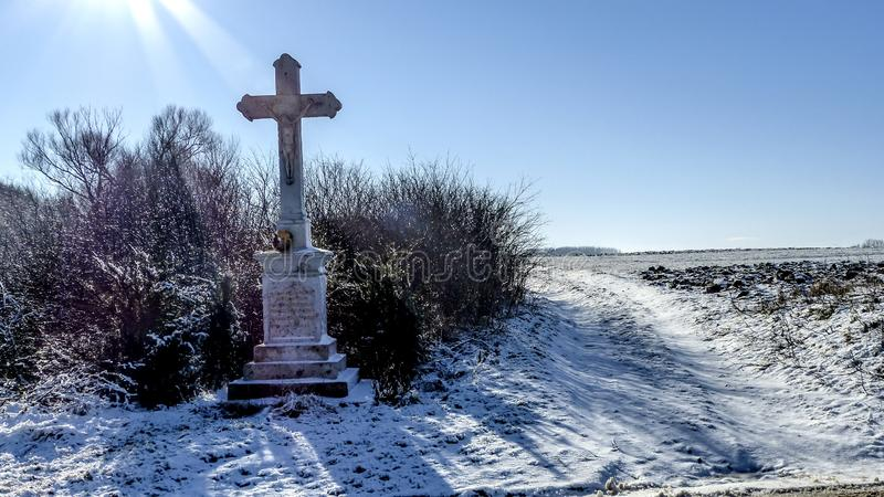 Winter landscape with cross stock photo