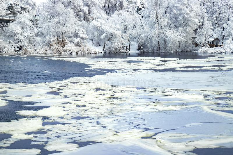 Winter landscape of the Dnepr river , covered with ice, snow and hoarfrost. Picturesque winter landscape on the Dnieper River, covered with ice, snow and royalty free stock image