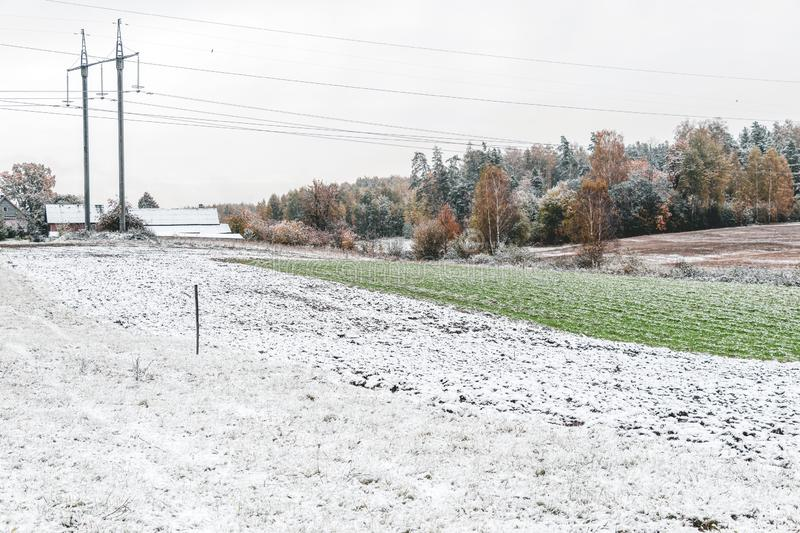 Winter landscape with first snow in the countryside fields with late autumn colors. Nature background with copy space, arable, plowing, plowed, cultivated stock images