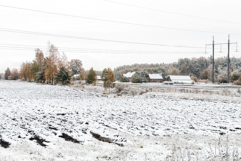 Winter landscape with first snow in the countryside fields with late autumn colors. Nature background with copy space, arable, plowing, plowed, cultivated stock image