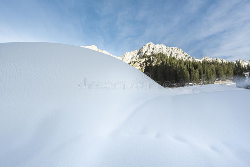 Snowdrifts in the Austrian Alps. Fluffy white snow on a sunny day. Winter landscape with fresh fluffy snow on a sunny December day. Alpine scenery with royalty free stock images
