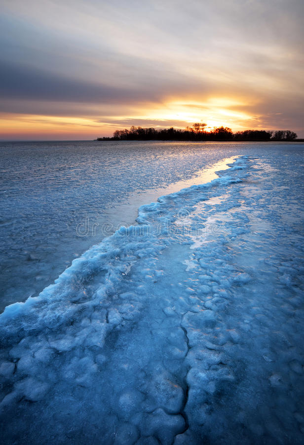 Winter Landscape With Frozen Lake And Sunset Sky. Stock ...