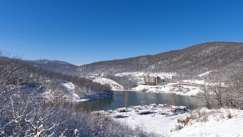 Winter landscape with a frozen mountain lake. Scene royalty free stock images