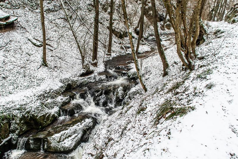 Winter landscape in the german mountains, snowy forest, trees in snow, winter creek, waterfall, nature near brodenbach stock images
