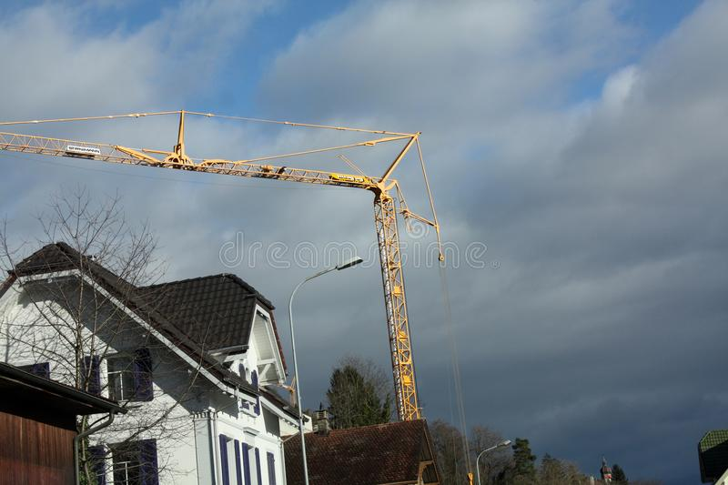 Winter landscape with houses and a construction crane. In Switzerland stock photos