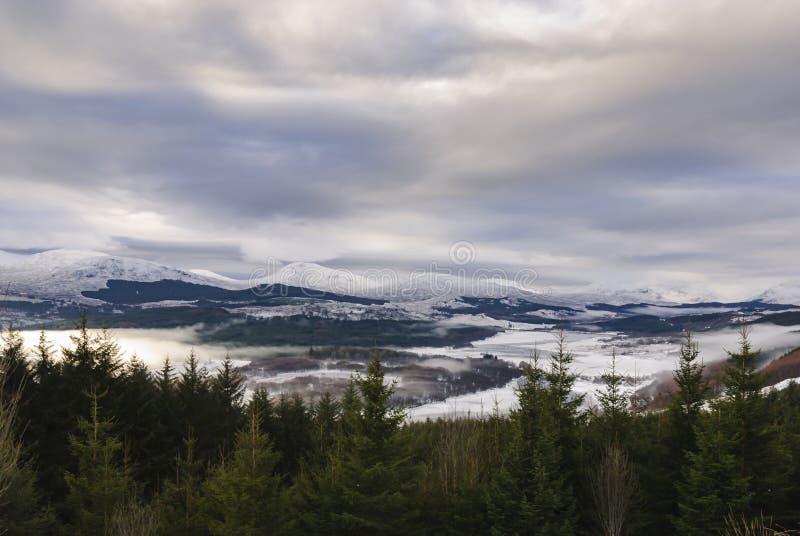 Glen Garry. A winter landscape image of Glen Garry and Loch Garry under a cloud inversion in Lochaber, Scotland royalty free stock photos
