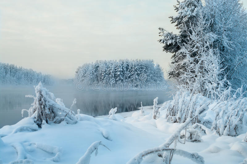 Winter landscape, islands and shore unfrozen lake in Russia royalty free stock photography