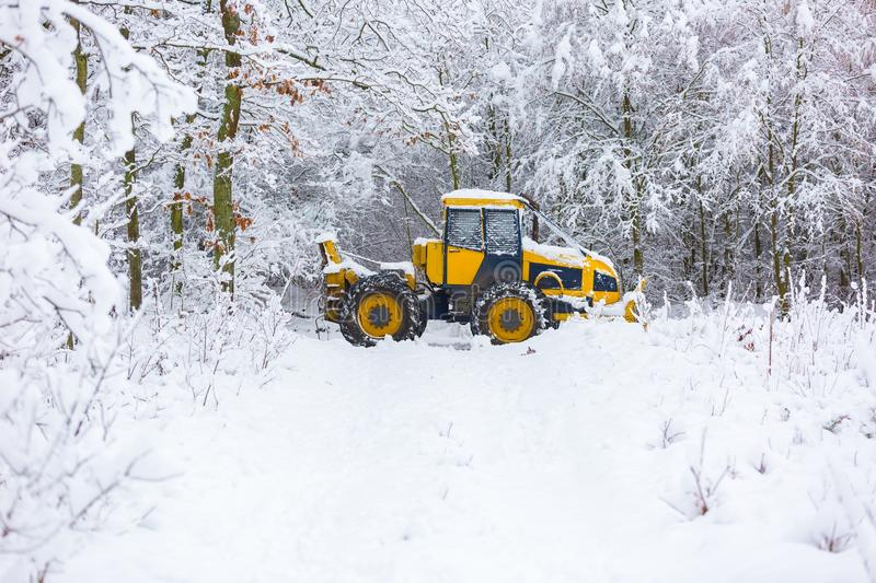 Winter landscape with machine (snow plow at work). Snow plow on winter road. Winter landscape with machine (snow plow at work stock image