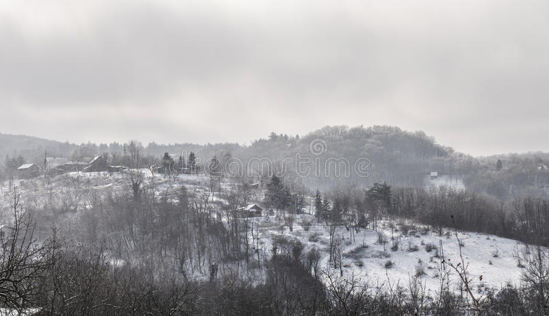 Winter landscape on mountain. Winter landscape. Small village on mountain covered with snow stock photography