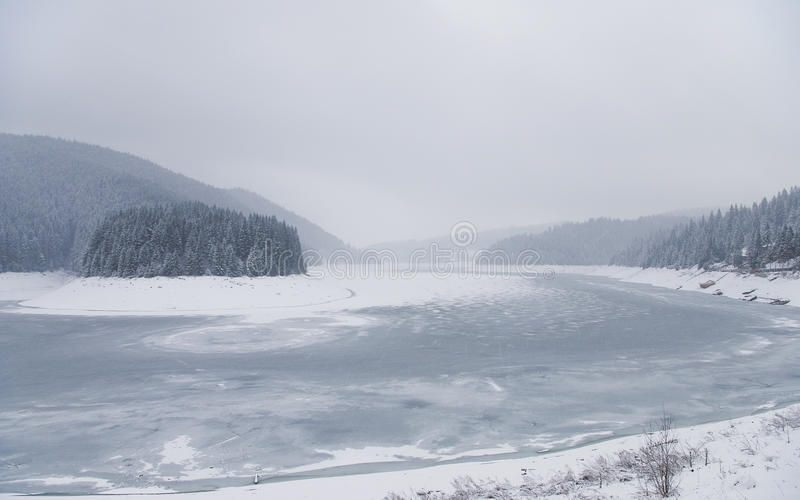 Winter landscape with mountain lake royalty free stock photography