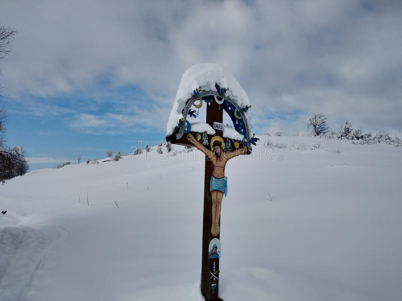 Winter landscape mountain peak the village of Parva, Romania Transylvania. Orthodox crucifix stock image
