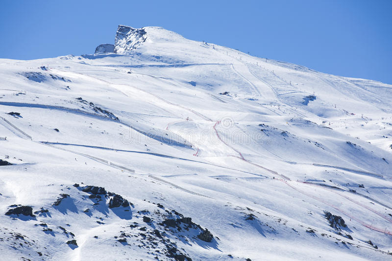 Winter landscape on mountain with ski lift and ski slope. Winter landscape on mountain with ski lift and ski slope in Sierra Nevada stock photo