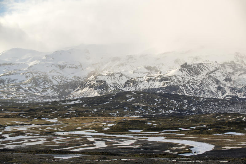 Winter landscape with mountains and snow storm clouds, Iceland royalty free stock photos