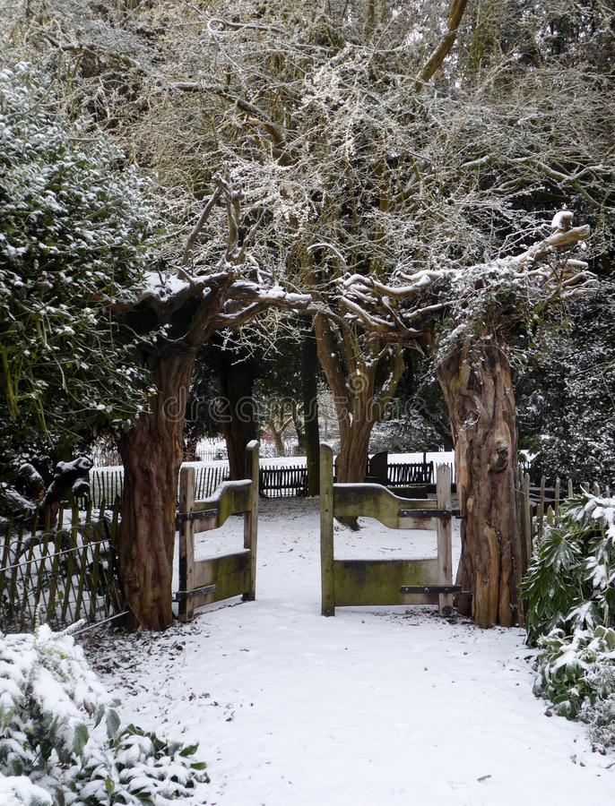 Winter landscape of the in the Musuem Gardens , York. A cold winters morning in the city of York , england, the Museum Gardens ,a tree arched gateway has a royalty free stock photography