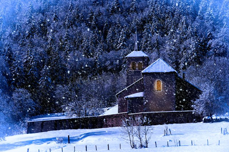 Winter landscape with a church at night royalty free stock photos