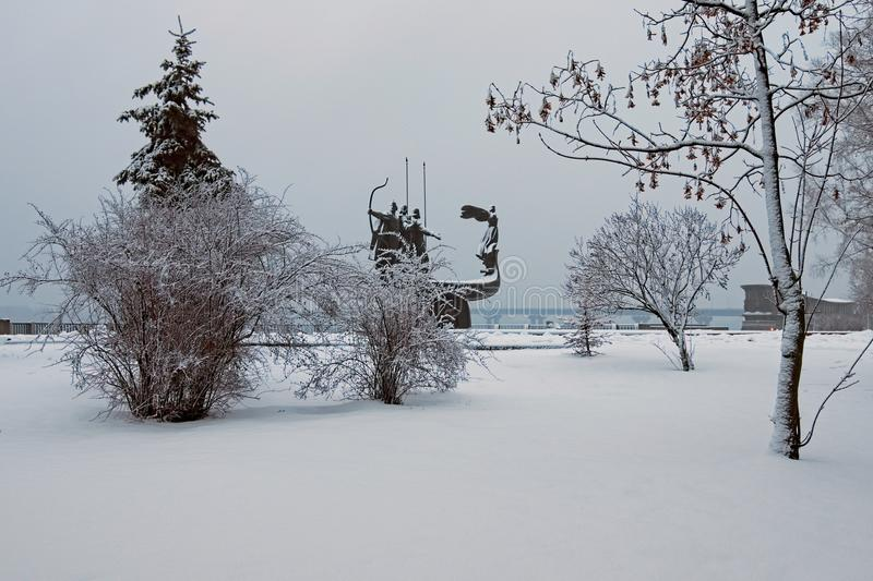 Winter landscape photo. Morning frozen with white trees and bushes. Monument of the Founders of Kyiv at the background. A few minutes before the snowfall stock photos