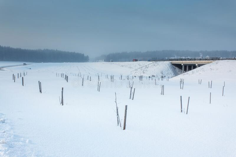 Winter landscape with the road and the bridge. In snow stock images