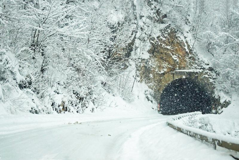 Winter landscape with a road and a tunnel stock photos