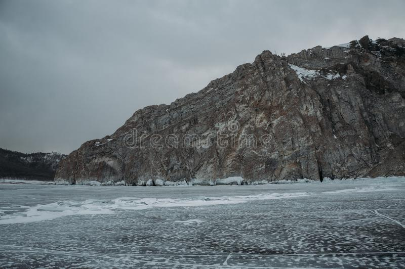 Winter landscape with scenic frozen lake, Russia,. Lake Baikal stock photo