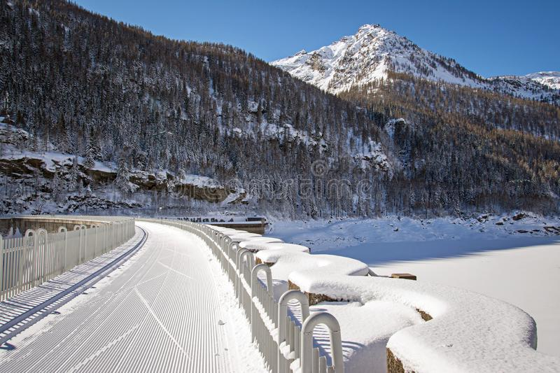 Winter landscape with ski tracks in the sunshine, italian Alps stock images