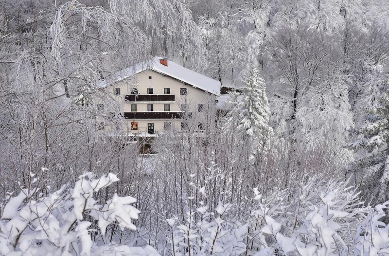 Winter landscape from Slovenia, area Zasavje. On the photo is winter landscape from Slovenia. View on the snowy mountain hut on the hill Mrzlica