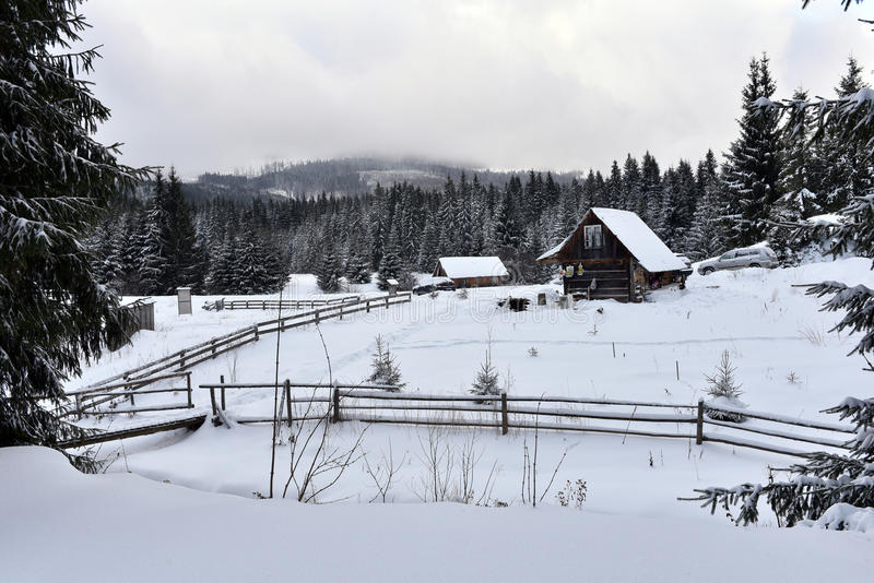Winter landscape with a small wooden hut royalty free stock photos