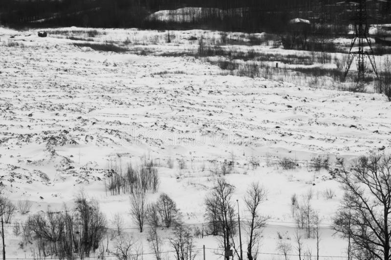 Winter landscape with snow covered field black and white. Winter landscape with snow covered field and trees, background, branch, cold, cool, country, day stock photos