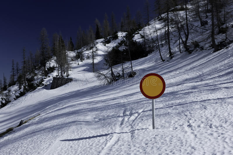 Winter landscape with snow covered road and traffic sign royalty free stock photos