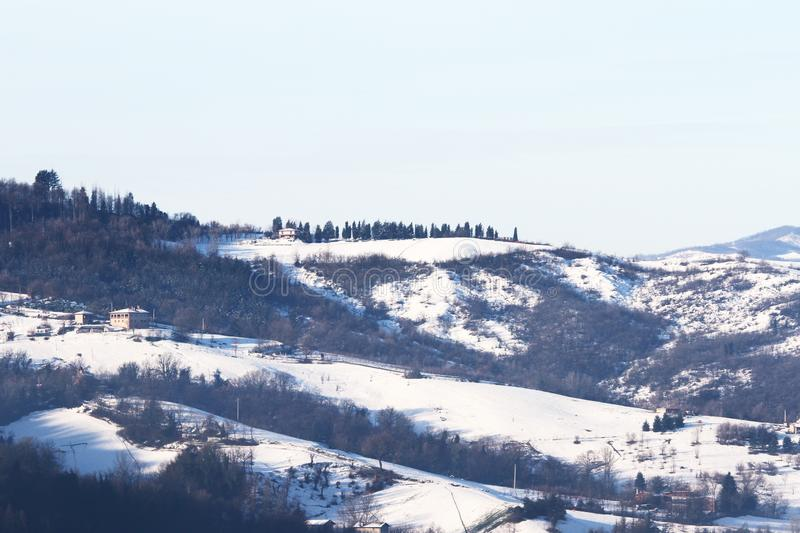 Winter landscape with snow and fog in the Tosco Emiliano Apennines, Bologna, Italy.  stock photography