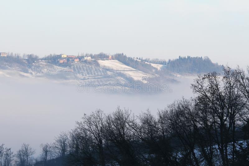 Winter landscape with snow and fog in the Tosco Emiliano Apennines, Bologna, Italy.  royalty free stock image