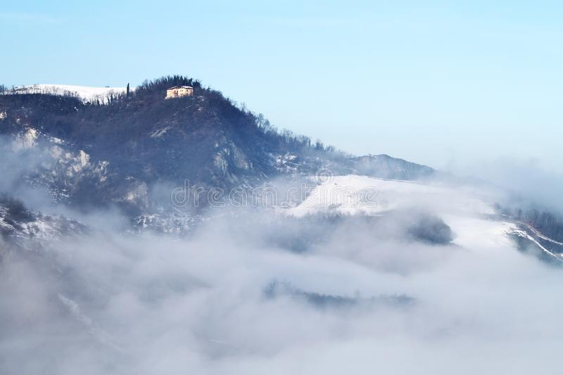 Winter landscape with snow and fog in the Tosco Emiliano Apennines, Bologna, Italy.  royalty free stock photos