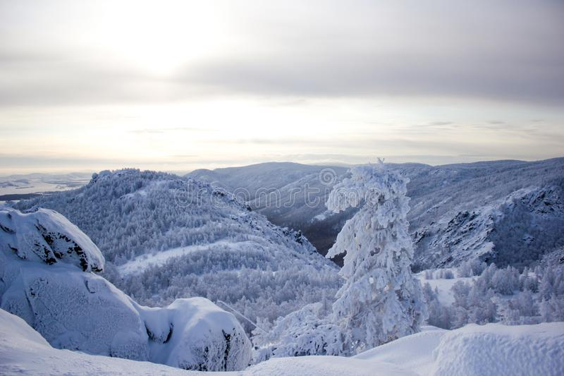 Winter landscape, snowy Ural mountains in cloudy day, Russia stock photography