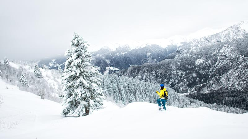 Winter landscape in a solitary snowshoeing on the Alps stock photography