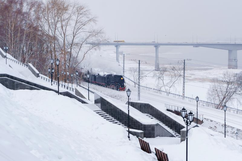 Winter landscape with a steam train royalty free stock image