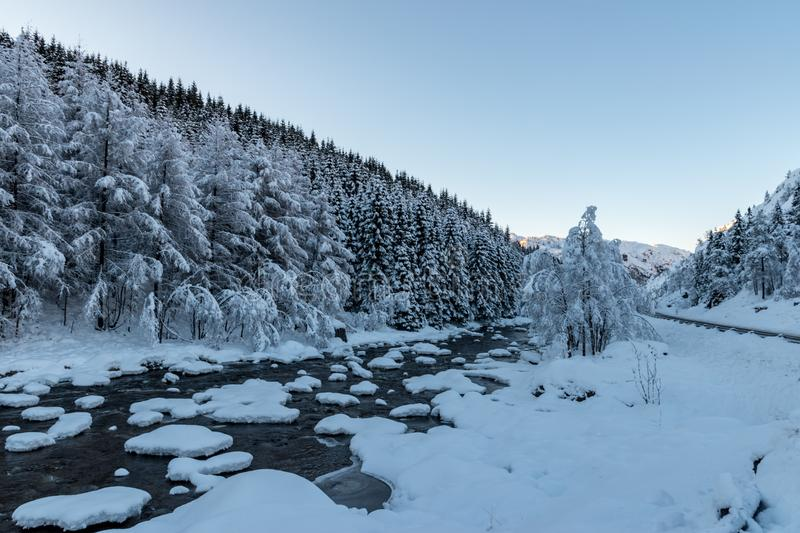 Winter landscape stones snow covered river. Winter landscape stones snow covered white stock images