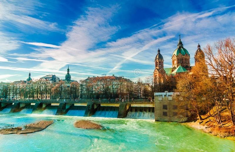 Winter landscape by turquoise Isar and St. Anna church in Munich. View on winter landscape by turquoise Isar and St. Anna church in Munich stock photo