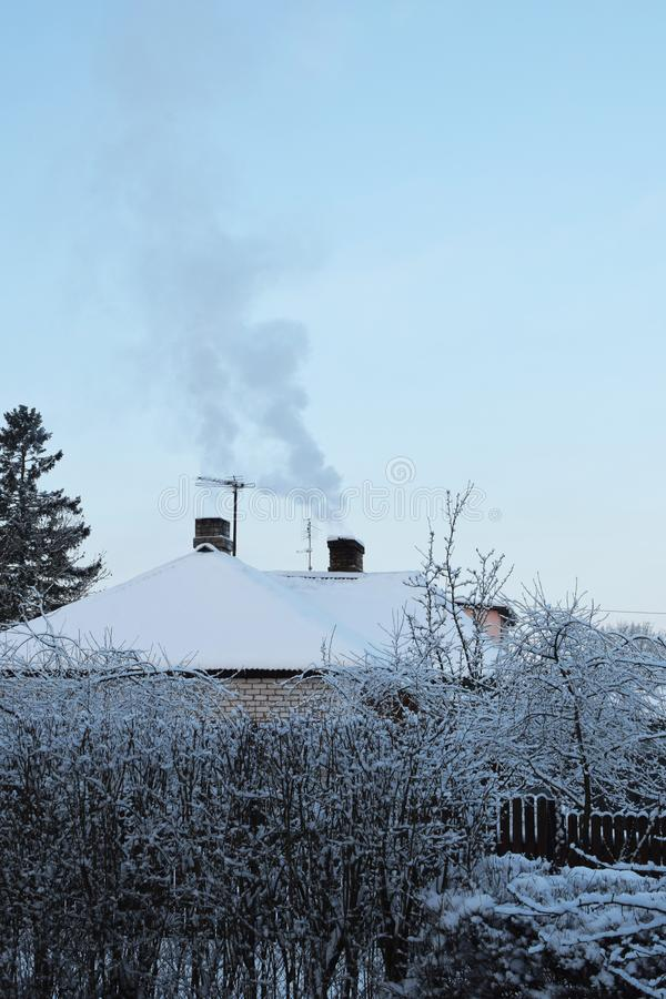 Winter landscape with two smoky chimneys stock photo