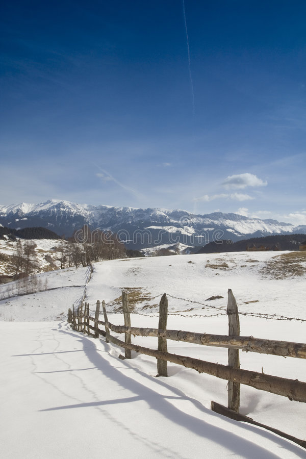 Winter landscape with wooden fence